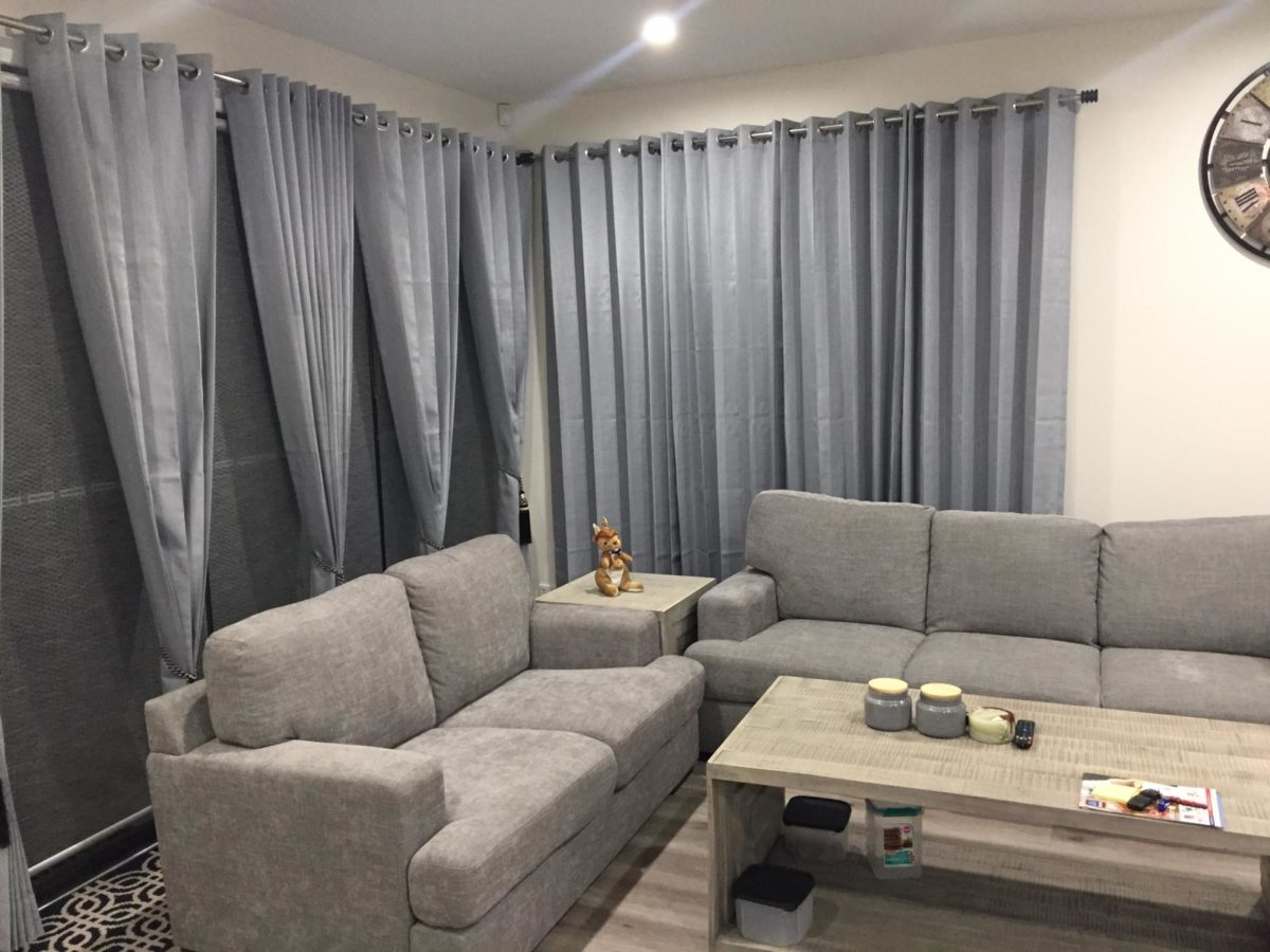 Matching Gray sofa With Designer Blinds