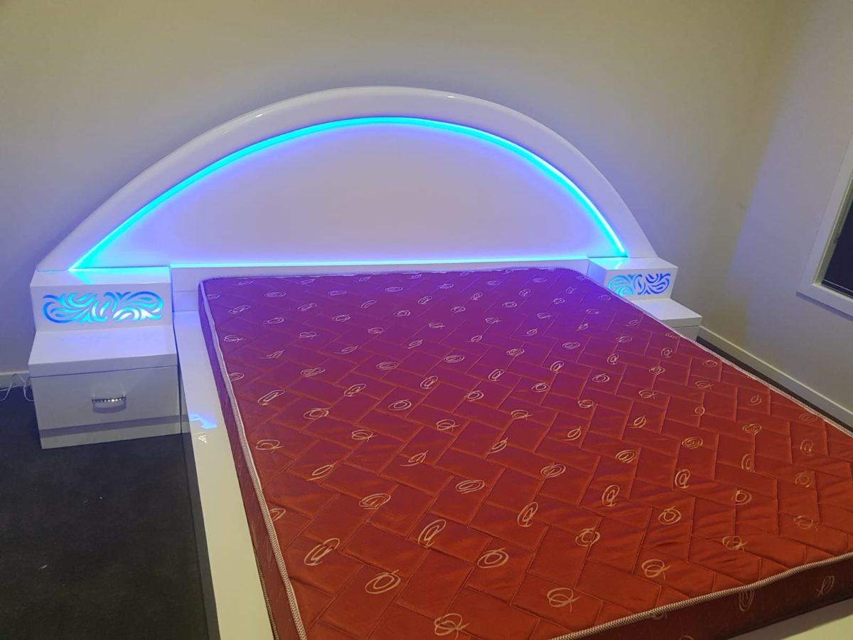 Elegant White Colored Double Bed with Blue Lighting